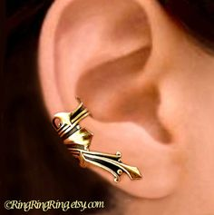 It fits easily on your right ear. These gold brass cartilage ear cuff earrings are for both women and men.. It is antiqued by oxidiztion and