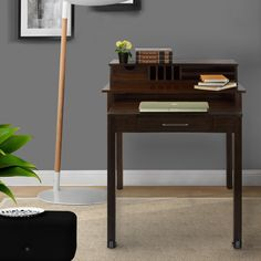 This 100-percent solid wood construction with beautiful espresso or warm brown finishes to choose ensures years of lasting beauty and structural integrity. This versatile desk features a pull-out lower desk for for additional space.