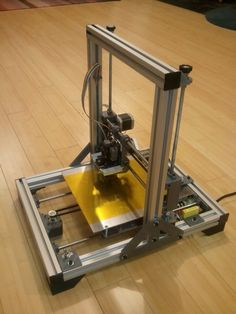 3D Printer by dkennell -- Homemade 3D printer constructed from aluminum extrusions, 3D-printed parts, and hardware. Equipped with NEMA-17 stepper motors, RAMPS controller, 100K thermistor-heated bed, and an extruder kit. http://www.homemadetools.net/homemade-3d-printer