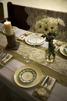 Burlap and lace place setting with table runner, mismatched China, daisies and church pew seating. See more rustic wedding ideas at mythreeweddings.com
