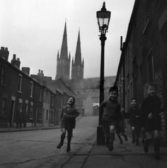 JOHN CHILLINGWORTH February Kids running through the streets of Belfast. Original Publication: Picture Post - 7029 - The Best And The Worst Of Some British Cities 5 - Belfast - pub. 1954 (Photo by John Chillingworth/Picture Post/Getty Images) Belfast Pubs, Black White Photos, Black And White, Pale Moon, Belfast Northern Ireland, Kids Running, First Novel, History, The Originals