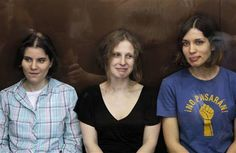 Members of the female punk band 'Pussy Riot' (R-L) Nadezhda Tolokonnikova, Maria Alyokhina and Yekaterina Samutsevich sit in a glass-walled cage during a court hearing in Moscow, August 17, 2012. REUTERS-Maxim Shemetov