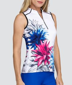 #lorisgolfshoppe Women's Golf Apparel offers a classy collection of golf skorts, shorts, dresses, and golf tops. You gotta see this ITALIAN HOLIDAY (Placed Blossoms) Tail Ladies Jewel Sleeveless Mini Mock Golf Shirts with unique , pretty colors!