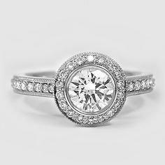 Platinum Round Bezel Halo Diamond Ring with Side Stones (1/3 ct. tw.)