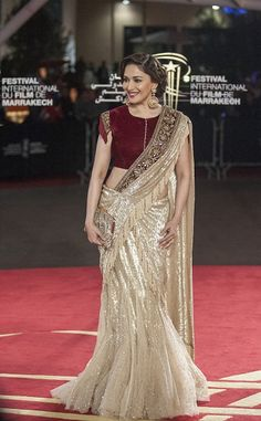View and license Madhuri Dixit pictures & news photos from Getty Images. Saree Gown, Bridal Lehenga Choli, Indian Designer Outfits, Designer Dresses, Indian Dresses, Indian Outfits, Designer Sarees Wedding, Modern Saree, Stylish Blouse Design