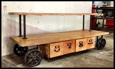 Rustic mango wood and raw steel combine to make this TV or entertainment console really sexy.