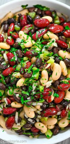 This Three Bean Salad is so flavorful. It makes a great side dish or topping, but can also be a healthy protein-packed snack, too. FOLLOW Cooktoria for more deliciousness! #beans #salad #vegan #vegetarian #plantbased #potluck #cooktoria