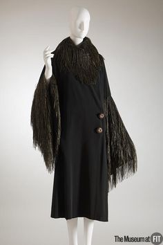 Coat | Designer: Paul Poiret (1879-1944) | France, 1908 | Black faille and gold thread | The Museum at FIT, New York