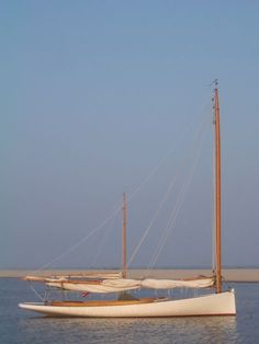 http://woodenboatworks.com/index.php/boats/custom/madigan