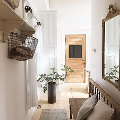 Beautiful hallway - love the wood bench and that glass door! eclecticallyvintage.com
