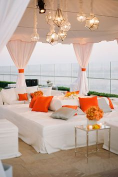 Mindy Weiss Shares the Top Wedding Trends | Wedding Planning, Ideas & Etiquette | Bridal Guide Magazine -This lounge area is so modern and yet comfy!  Maybe I could do something like this with my colors of yellow, gray and white!