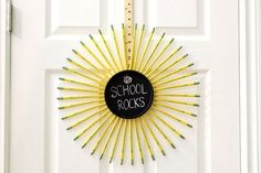 Make a wreath with pencils, a chalkboard and a yard stick to decorate for back to school or to give as a teacher-appreciation gift. Pencil Wreath, Yard Sticks, Teacher Appreciation Gifts, Chalkboard, Easy Diy, Backyard, Wreaths, How To Make, Decor
