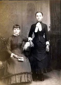 Two girls pose for a Victorian post-mortem photograph