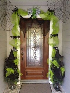 "Witchy Door Decor--Decorate your doorway this Halloween using green ""Halloween ribbon"" and a few other materials and decorations. Make it look extra cool by stringing up some Christmas lights underneath to make everything stand out even after it's dark."