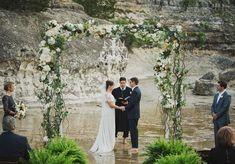 Wedding Ceremony in the Pedernales River | Liv by Design | Ariel Renae | STEMS Floral Design  #texaswedding #hillcountrywedding