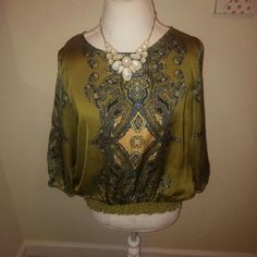 Silky APT 9 Blouse Classy olive green blouse. Stretchy bottom, flowy top and sleeves. Feels very silky...100% polyester. Petite large. Would fit a Medium. Apt. 9 Tops Blouses