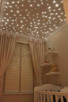 Paint a board, drill holes, string lights in holes, hang above bed, surround with crown molding