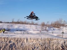 This picture screams adrenaline to me, and it is even better because it has to deal with snowmobiles. This snowmobile is in a race and had just hit a table-top jump. Getting in the air like that is one of the biggest adrenaline rushes that you could get. This would be a part of the good life for sure.