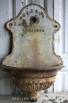 Cast Iron Sink.  I have used one similar to this on the front of my house as a planter.