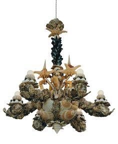 Chandelier of shells, handmade by Mishmash. www.mishmash.nl