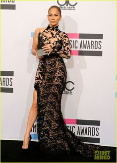 Jennifer Lopez wears Zuhair Murad as she poses with her trophy in the press room at the 2011 American Music Awards held at Nokia Theatre