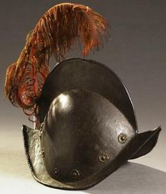 An early 17th century Combed Morion Helmet, with a crescentic brim terminating to a point on both the front and back of helmet complete with a high comb along the center line of the bowl.
