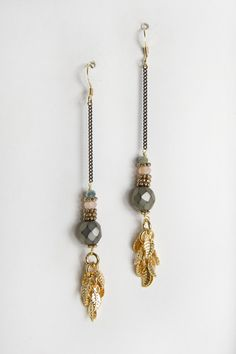 Beautiful stone bead with gold leaf charms