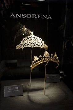 The Ansorena strawberry leaf tiara on show, with an intricate diamond foliate scroll tiara, topped with a pear-shaped pearl