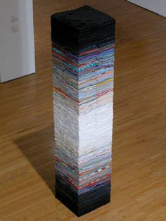 A column sculpture made of used clothes, the colors organize it visually...