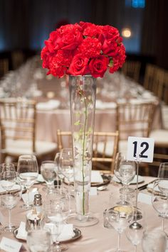 Carnations and Roses Centerpiece. Red. With shorter vase and rhinestone ribbon wrapping around the case for bedazzle. Adding some crystals inside the vase.