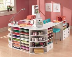 craft desk. plenty of work space and organizable storage space. this would be extra cool with lazy susan-type corners on the end and more drawers in place of some of the shelf spaces for ribbon, tools, fabric paint, and stuff that otherwise won't stack neatly in a shelf. I NEED THIS!!!