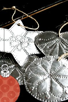 Punched Tin Ornaments--the round one reminds me of a sand dollar.