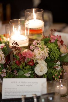 A romantic wedding reception centerpiece. Photo by Robert Paetz Photography. #weddingbouquets #weddingflowers #weddings #bouquets #roses #altar #ceremonydecor #weddingdecor #candles