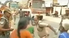 As the protesters refused to disperse, Additional Deputy Superintendent of Police slapped one of the women and pushed two others.    A senior police official slapped a woman protester during a crackdown on an anti-liquor agitation in n