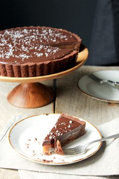 salted caramel chocolate tart - FOR THE CARAMEL: 1 ½ cups sugar 3 tbsp. light corn syrup ¼ tsp. kosher salt 6 tbsp. unsalted butter 6 tbsp. heavy cream  FOR THE GANACHE: ½ cup heavy cream 4 oz. bittersweet chocolate, finely chopped Fleur de Sel  for garnish