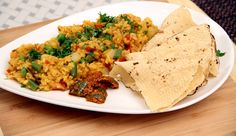 Masala Khichdi is a spicy variation of the simple khichdi. It is very healthy and the ultimate Indian comfort food prepared using rice and lentils. Spicy Recipes, Easy Healthy Recipes, Indian Food Recipes, Vegetarian Recipes, Cooking Recipes, Masala Khichdi, Lose Fat Fast, Best Protein, Food Dishes