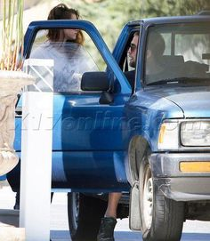 Rob and Kristen out with their dog, Bernie, at a gas station in LA, 4-18-13 (17)