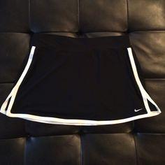 Nike dri-fit tennis skirt Size large Nike Dri-fit tennis skirt. Very light wear. No pilling. Bundle and save! Nike Skirts