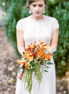 orange and green bridal bouquet - photo by Casey Rose Photography http://ruffledblog.com/farmhouse-inspired-wedding-ideas