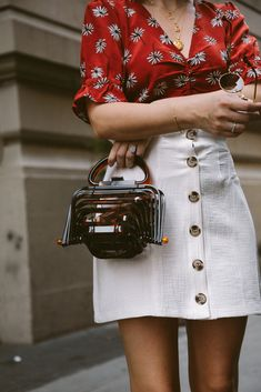 Weekends in the City. An essential for summer, the white denim skirt is a summer essential