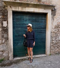 Island attire in a jumpsuit from Club Monaco, Birkenstocks, Céline sunglasses and a straw hat