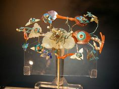 Manchu hair pin: coral, enamel, Kingfisher feathers, and a jade cameo. The Gina Hellweger Collection