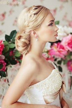 A supremely elegant braided updo with a bun tucked into the nape of the neck / wedding hair / bridal hairstyle