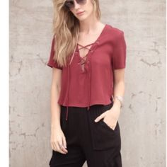 Wine colored crop top Purchased on here but didn't work for me. Size large but fits more like a medium. Tops Crop Tops