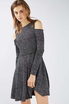 Mix up your party look in this cold-shoulder dress in an all-over glitter finish. With long sleeves, it comes with a pleated skirt and features pretty tie-back detail. Compliment with ankle boots to keep the look on-trend. #Topshop