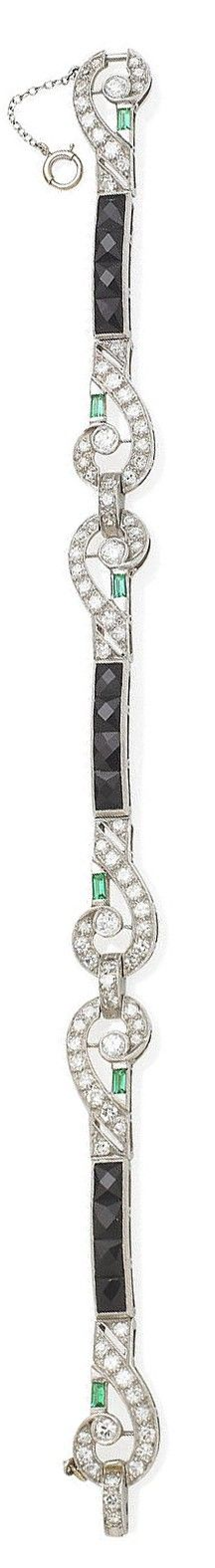An art deco onyx and diamond bracelet, 1920s. Composed of three articulated sections, each centring upon a faceted onyx line between a pair of scrolling panels, millegrain-set throughout with old brilliant-cut and single-cut diamonds, with baguette-cut green paste accents, diamonds approximately 3.00 carats total, length 18.5cm #tiffany tiffany gold bangle price