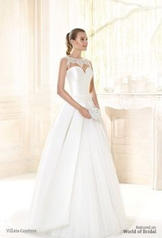 Strapless sweetheart neckline wedding dress. The floaty silk tulle skirt is covered with a pleated mikado overskirt. The bodice is decorated with beadings applications. Triple bow in the center of the back.
