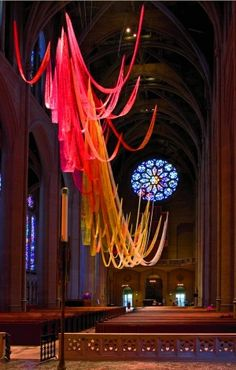 "Nancy Chinn installed fifty pieces of acrylic-painted netting to undulate in the air above worshippers in San Francisco's Grace Episcopal Cathedral. The ""Tongues of Fire"" installation celebrated the Christian festival of Pentecost."