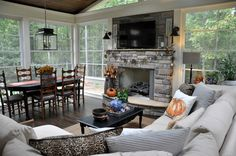 Beautiful Sunroom decorated for fall! Love the separate dining and living areas with the fireplace! Such a cozy escape!