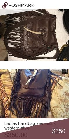 Beautiful leather Love Heals Purse Softest leather ever!! Amazing purse its just not my style perfect for summer!!! Purse is flawless!! Love Heals Bags Crossbody Bags